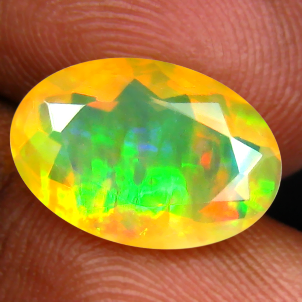 2.75 ct Mesmerizing Oval (13 x 9 mm) Un-Heated Ethiopia Rainbow Opal Loose Gemstone