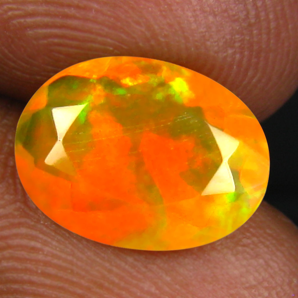 1.79 ct Resplendent Oval (12 x 8 mm) Un-Heated Ethiopia Rainbow Opal Loose Gemstone