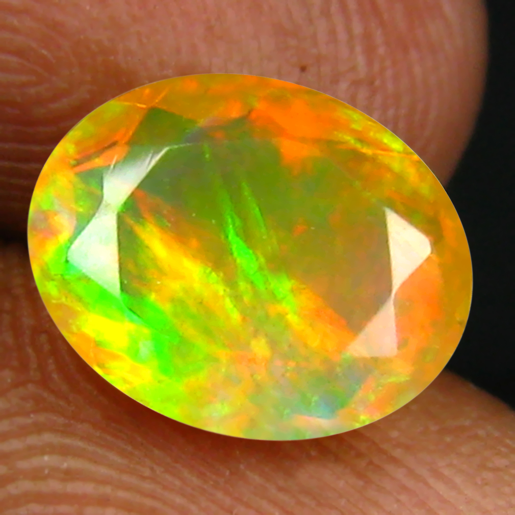 1.48 ct Eye-opening Oval (9 x 7 mm) Un-Heated Ethiopia Rainbow Opal Loose Gemstone