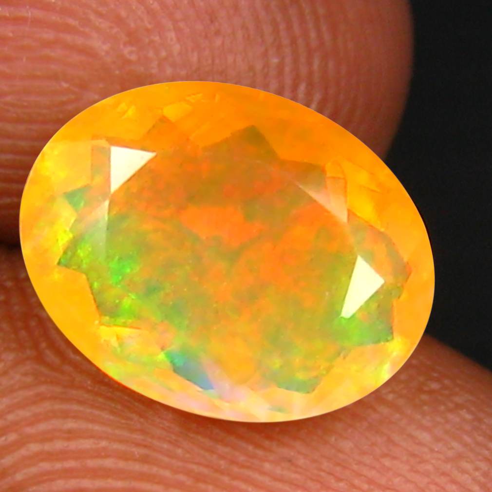 1.78 ct Excellent Oval (10 x 8 mm) Un-Heated Ethiopia Rainbow Opal Loose Gemstone